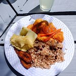 Fried fish fixed Caymanian style, fried plantain, black beans and rice, island vegetables, potat