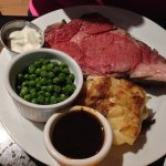 Prime Rib with Potato gratin and green peas