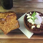 Baked beans with a poached egg, persian feta and house made GF bread. Amazing!!