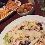 Caesar salad with chicken, a side-order of garlic potatoes and chicken stips with skinny fries!