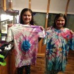 Tie dying shirts at the activity center