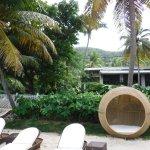 Shady pods, hammocks, and beach chairs