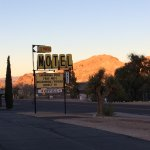 Front of motel around sunset