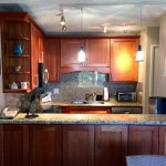 Remodeled kitchen with granite counters and cherrywood cabinets