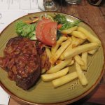steak with bacon and onion sauce, chips, and salad