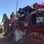 Hanging on to the fire truck....the Happy Homewreckers crew. Our second home.