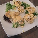 Deviled eggs topped with crab meat.