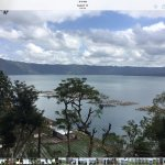Lake Batur is a volcanic lake situated in an huge calderあ
