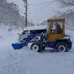 Takeshi clearing snow