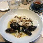 Cod cheeks with cockles and mussels