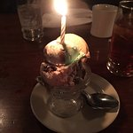 Delicious spumoni dessert and candle