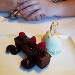 Dark chocolate ganache torte, chia ice cream,cherry compote,raspberries,rice puff pearls