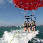 Up to 3 can enjoy Parasailing memories high above Ft Myers Beach.