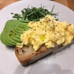 Scrambled eggs with avocado on sourdough