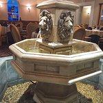 Lovely fountain with fish in it in the centre of the restaurant