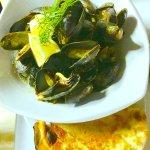 PEI mussels , saffron cream sauce , focaccia shards