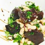 Roasted beet salad , cannelini beans , arugula , olivier oil drizzle.