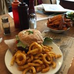 Classic kino burger with curly fries. Sweet potato fries.