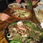 Red plate is specialty dish and black plate is fajitas