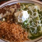 Cheese enchilada with verde sauce, sour cream, beans, rice.