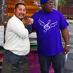 """Philip meeting one of the vendors using an outside """"yatai"""" (food stall)."""