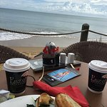 "Breakfast by the sea try ""Eggs in the Beach"" scramble with salmon. Coffee not our fav but a grea"
