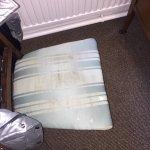 Filthy bedroom chair in bedroom 6