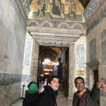 Aykut pointing out some of the secrets of the Hagia Sophia.