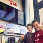 Jamal , owner of the restaurant together with my son and certificates of excellences