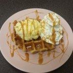 Waffles, ice cream, cream and toffee sauce.