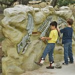 Four educational play stations where you dig for dinosaur bones.
