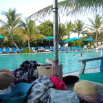 Poolside at the beach club. large pool never crowded and heated. Plenty of chairs and loungers