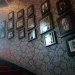 stairway filled with pictures of rock legends