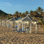 Chairs and cabanas on the beach - first come, first served