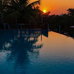 Looking west into one of many incredible Belizean sunsets at the main pool.