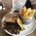 Steak & ale pie, chips, gravy, veg underneath pie