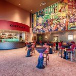 Patrons can enjoy pre-show drinks in the lobby while enjoying the memorable mural of Broadway.