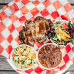 Smoked Brisket, Seasonal Salad, Baked Beans and a special side. Photo Credit: Sam Dean photograp