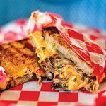 Our Grilled Pimento Cheese sandwich with Pork added, as featured in Our State Magazine.