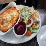 meat lasagne with full salad