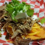 Loaded Sweet Potato with cheddar cheese, pulled pork, sour cream and cilantro.