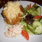 Jacket potato with cheese and salad.