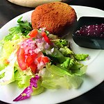 Fried breaded cheese with our homemade bread, cranberry-jam and a green salad