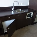 Kitchenette with crockery and cutlery