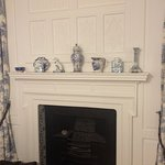 The fireplace in the 'Blue & White' bedroom