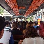 passengers (guy in helmet is the money collector)