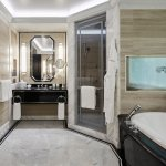 The majestic marble bathroom of the Fifth Avenue Suite.