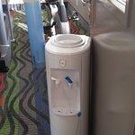 water cooler used as doorstop