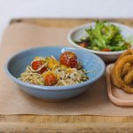 Crab Linguini, double crumbed onion rings, cherry tomato salad