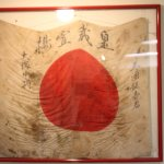 Japanes flag with writing on it